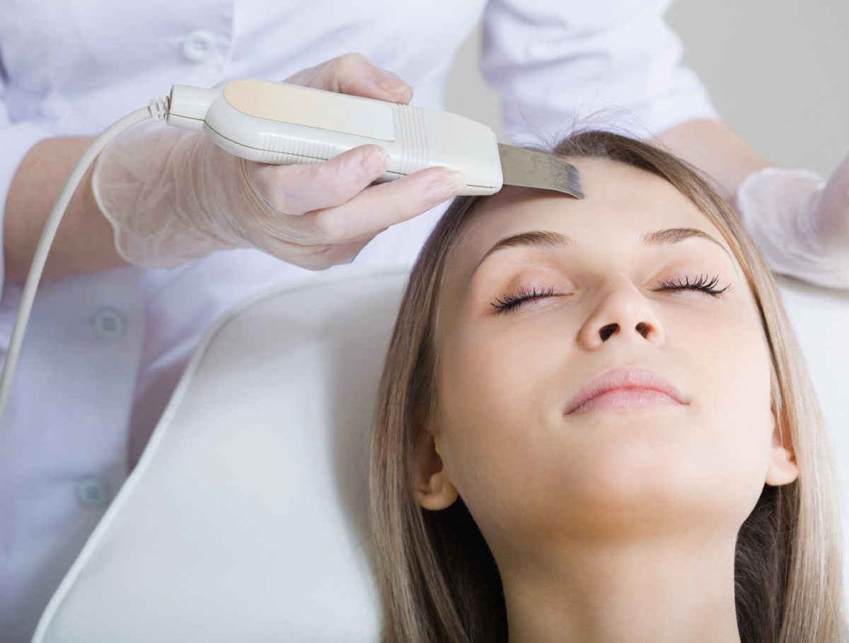 woman-lies-on-a-table-in-a-beauty-spa-getting-a-treatment-1200x910.jpg
